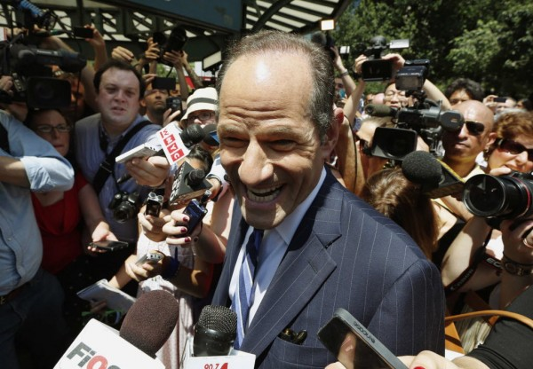 Former New York governor Eliot Spitzer speaks to reporters during a campaign event in New York, July 8, 2013.