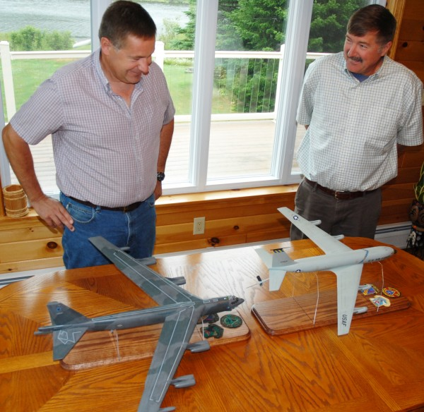 Brothers David Bouchard (left) and Michael Bouchard recall their days spent as crew chiefs on military aircraft on the former Loring Air Force Base. This past week,the brothers were presented scale models of the B-52 bomber and KC-135 tanker planes they maintained.