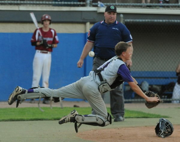 Hampden catcher Noah Gardner dives in an attempt to catch a popup during fourth-inning action of the District 3 Junior League championship Monday night at Mansfield Stadium in Bangor.
