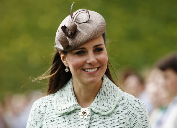 Britain's Catherine, Duchess of Cambridge attends the National Review of Queen's Scouts at Windsor Castle in Berkshire, near London in this April 21, 2013 file photo. Wife of Prince William, she gave birth on Monday to the couple's first child, a son who will be third in line to the British throne.
