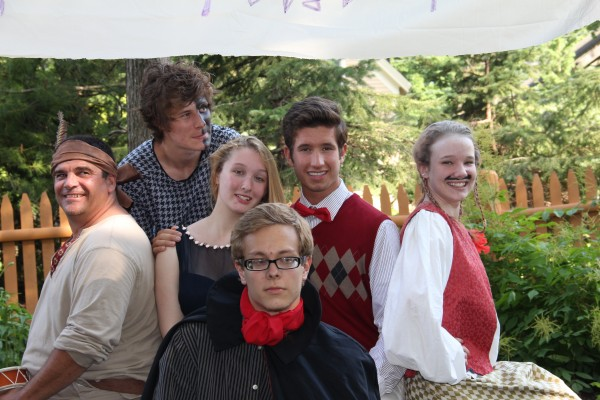 The cast of the Fantasticks, left to right: Randy Nichols, Robert Porter, Dakota Wing, Maggie Goscinski, Grant Richards, Autumn Stupca, and Peter Clain, with Mert Danna kneeling in front.  All photos by Katie Buckley