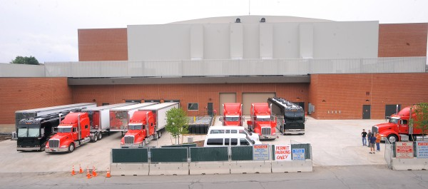 The trucks and buses for the band and crew for Phish are parked behind the Cross Insurance Center Monday afternoon.