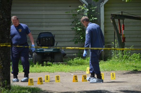 State police evidence team members mark off evidence outside of 24 Main St. in Detroit late Thursday morning. A body was removed from the home. The death is being referred to as suspicious.