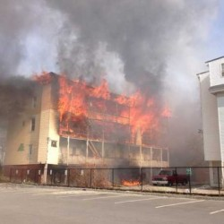 Fire consumes an apartment building at 111 Blake Street in Lewiston in April 2013. Prosecutors decided Thursday they would not seek to have a 13-year-old Lewiston boy tried as an adult on arson charges for the fire that burned the three downtown Lewiston buildings and left 75 people homeless.