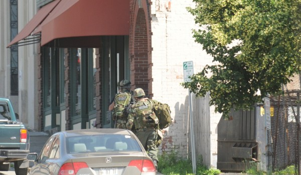 Tactical units enter a building where a man is firing dozens of shots in downtown Bangor.