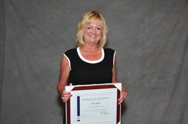 Tina Jamo, VP of Operations for Katahdin FCU, with the Jeannette G. Morin Award for Outstanding Credit Union Employee.