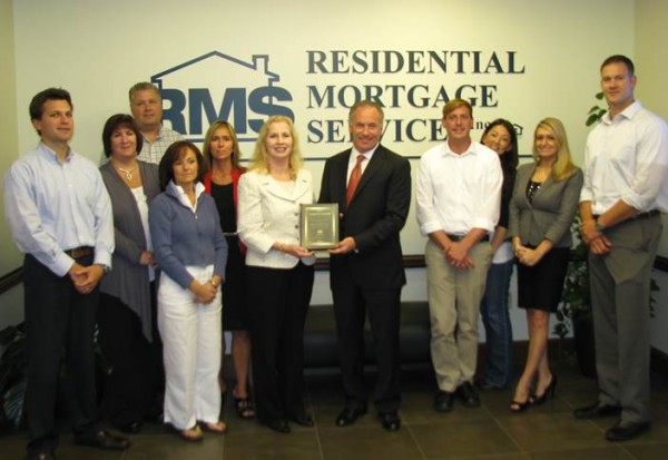 "USDA Rural Development State Director Virginia Manuel (center) presents Residential Mortgage Services, Inc. Vice President and Sales Manager Michael Ianno with the USDA Rural Development ""Homeownership Partner of the Year 2013."""