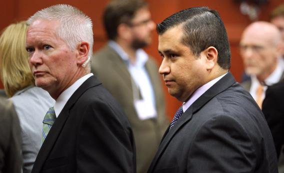 George Zimmerman (right) is escorted from the courtroom a free man after being found not guilty on the 25th day of his trial at the Seminole County Criminal Justice Center on Saturday in Sanford, Fla. Zimmerman was charged with second-degree murder in the 2012 shooting death of Trayvon Martin.