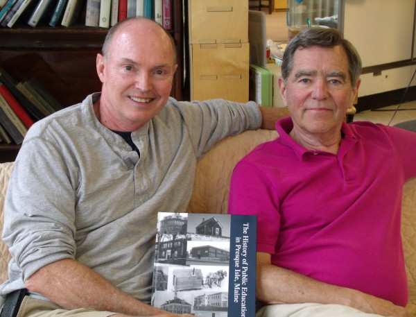 Dr. Gehrig Johnson, left, superintendent of schools in SAD 1, and Dick Graves, author of The History of Public Education in Presque Isle, Maine 1837-2012, showcase the book, a 242 page historical work and comprehensive survey of the development and growth of the city's school system, during an interview in Presque Isle on Friday, Aug 2, 2013. The book includes a detailed 50-page timeline with numerous features, including those directly responsible for the district's 175-year educational success, profiles of some of the most important educators, basketball coaches and their teams from 1903, colored photos of the last days of Cunningham School and all 1,000 point basketball players from 1954. It went on sale Aug. 7.