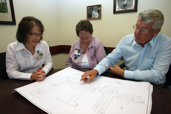Houlton Regional Hospital is going through some changes to cut expenses. Going over the plans recently are (from left) Cynthia Thompson, chief financial officer; Lois Rockwood, accute care nursing manager; and Tom Moakler, chief executive officer.