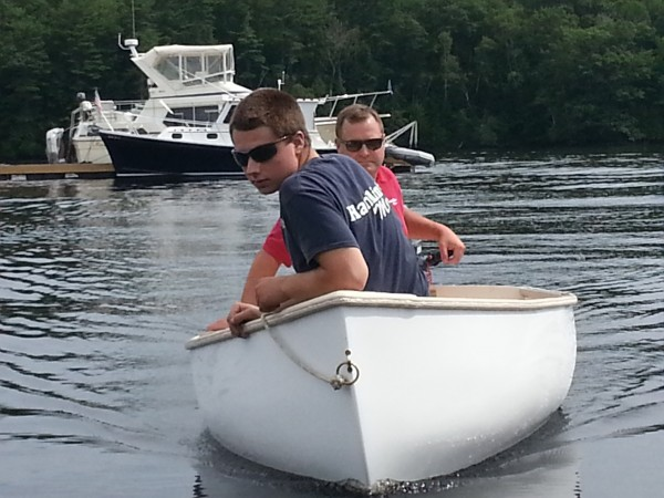 Hamlin's Marine employee Ethan Dysart (foreground) and General Manager Dan Higgins take a Puffin dinghy made in the company's facility out for a spin on the Penobscot River on July 25, 2013.
