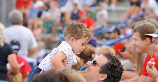 John Gibboni of Hampden picks up his son two-year-old Johnny while watching the Bangor versus Philippines game during the 2013 Senior League World Series in Bangor Monday.  This was the first World Series the Gibboni family came to watch.