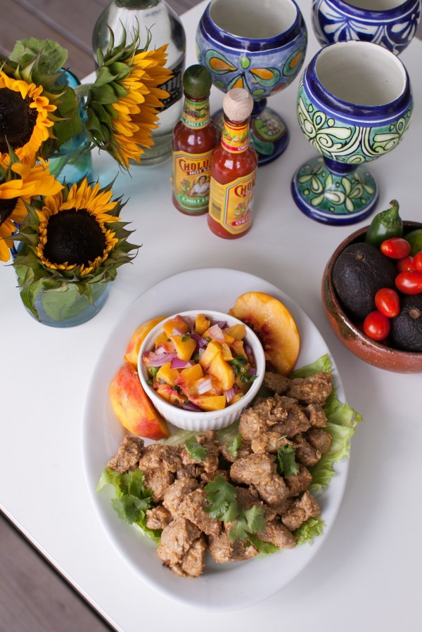 Creating a taco bar at home is no longer the realm of ready-to-go kits with spice packets and jarred sauces. Making your own versions is the way to go with fillings such as this pork al pastor with peach salsa.