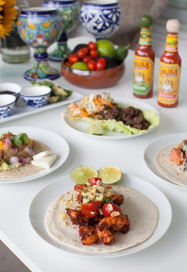 Creating a taco bar at home is no longer the realm of ready-to-go kits with spice packets and jarred sauces. Making your own versions is the way to go with fillings such as this shrimp in adobo alongside roasted corn, tomato and onion salsa.