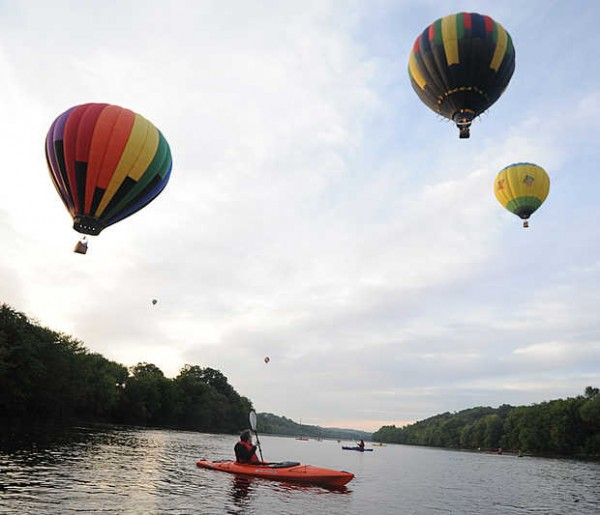 Balloons hover over the Androscoggin River Sunday morning.