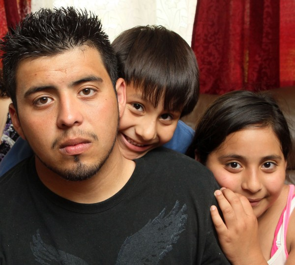 Pedro Morales (from left), 19, poses for portrait with his brother Joseph, 6, and sister Sharon, 10, at their Dalton, Ga., home, on April 30, 2012. Pedro, who was illegally brought to the U.S. by his parents when he was 7, was relieved to be back home in North Georgia after being freed from a detention center and told he would not be deported to Mexico. But those happy feelings have given way to anxiety. He still does not have legal status in the U.S. And the government won't permit him to work legally here.