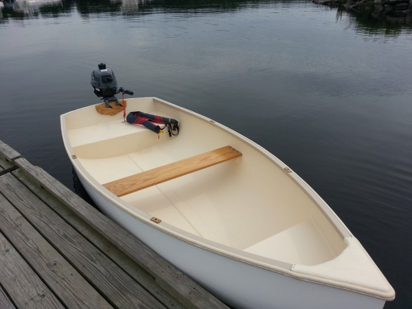 A Puffin dinghy made in Hampden, Maine, tied to the dock at Hamlin's Marina on the Penobscot River in Hampden.