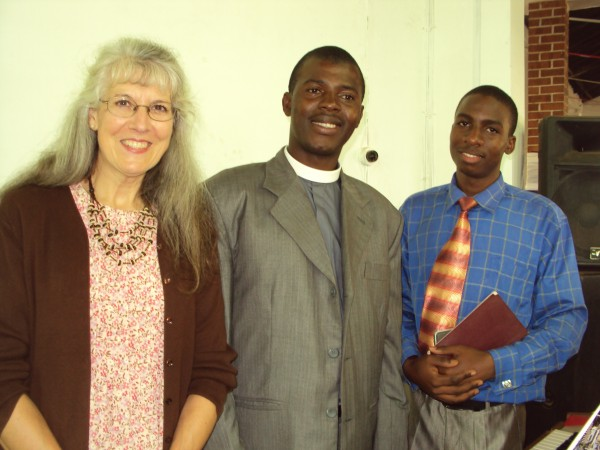 Beth Bradshaw of Hulls Cove (left) last year met the Rev. Asaph Wasswa (middle) and Godfrey (last name unknown at the lutaaya Theological college and Vocational Center in Mityana, Uganda.