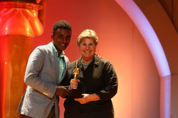 Cal Hancock of Hancock Gourmet Lobster Co. in Cundy's Harbor receives her 10th gold from celebrity chef Marcus Samuelsson at the Fancy Food Show in July.