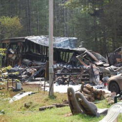 Two families escaped a fire early Wednesday that ripped through the mobile home they were living in at 160 Pine Ridge Loop in Livermore Falls.