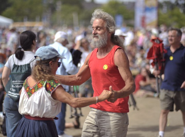 Bob Klein and Kim Jacobs, left, dance away at the Railroad Stage and have been enjoying the 2011 Folk Festival in Bangor.