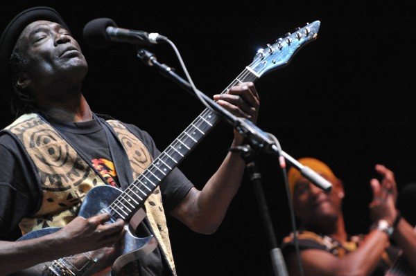 Congolese musician Samba Ngo, left, mezmerizes the crowd at the Railroad Stage at the 2011 American Folk Festival on Bangor's waterfront.
