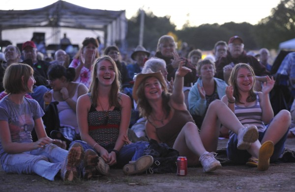 Robyn Metcalf (from left), 15, Shannon Hardy, 15, Sierra White, 15, and Robyn's sister Kyra Metalf, 16, all of Massachusetts, carpooled to Bangor to soak in the bluegrass band Rich in Tradition and other attractions at the 2011 American Folk Festival.
