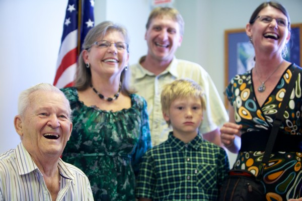 World War II veteran Roger Levesque, 89, of Springvale (left) smiles while being given a new set of military medals, Monday in U.S. Rep. Chellie Pingree's Portland office, replacing his originals, lost in a house fire. With him are family members (from left) daughter Patty McKeon, grandson-in-law Scott King, great-grandson Gage King and granddaughter Tina King.