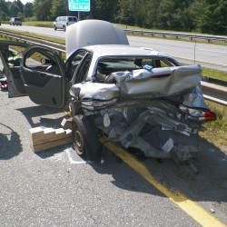 Driver summoned after state trooper's cruiser broadsided on Turnpike