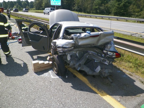Responders at the scene of a crash Wednesday on the Maine Turnpike.