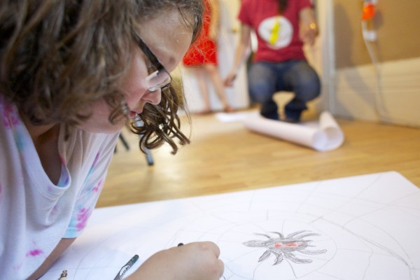 Solomon Finch, 10, makes a drawing during a session by local artist &quotPigeon&quot who volunteered to help teach kids about street art and the art he makes in the Bangor area during a group therapy class Friday afternoon at Higher Ground Services in Brewer.