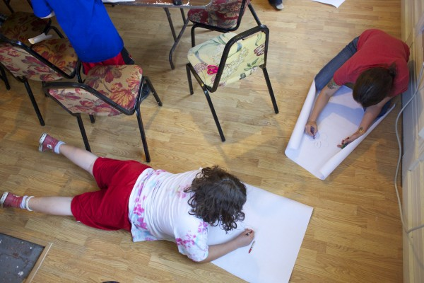 From left, Solomon Finch, 10, and Haley Beem make drawings during a volunteer session by local artist &quotPigeon&quot who helped teach kids about street art and the art he makes in the Bangor area during a group therapy class Friday afternoon at Higher Ground Services in Brewer.