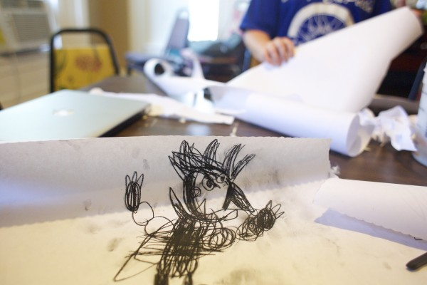 Leo Horchler, 8, made a drawing during a street art talk by local artist &quotPigeon&quot who volunteered to help teach kids about street art and the art he makes in the Bangor area during a group therapy class Friday afternoon at Higher Ground Services in Brewer.