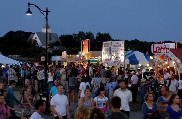 Vendors light up as night falls on the American Folk Festival in Bangor on Aug. 25, 2012.
