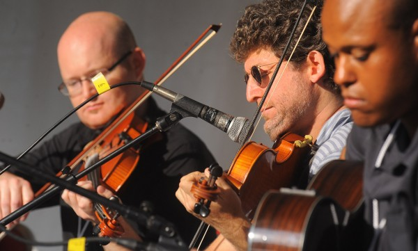 Members of the Old Bay Ceili Band perform during the American Folk Festival on  Aug. 25, 2012, at the Bangor Waterfront.  Pictured are (from left) Sean Clohessy, Danny Noveck and Josh Dukes.
