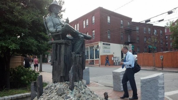 A passer-by seems barely aware of Portland's monument to John Ford, the legendary Hollywood film director, at Gorham's Corner, the intersection of York, Center, Pleasant, and Fore streets. This weekend the city is commemorating Ford, who grew up on Munjoy Hill.