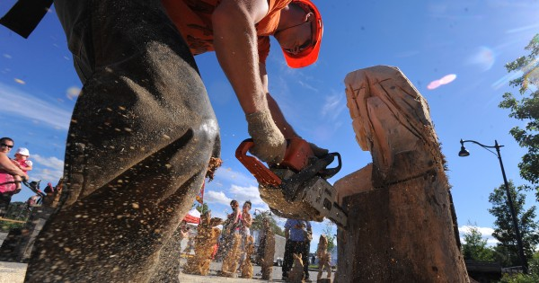 Chainsaw artist Pasco Grove of Searsport works on a carving during the KahBang Festival in Bangor on Saturday.