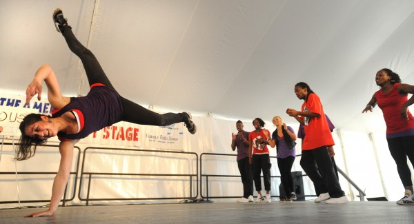 Hannah George-Wheeler (left) does a form of break dancing known as b-girling during the Dance House portion of the Urban Artistry group at the 2010 American Folk Festival.