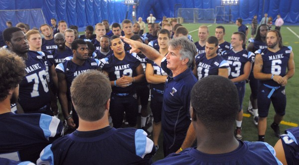 The University of Maine's football head coach Jack Cosgrove speaks to the players during media day in Orono Friday.