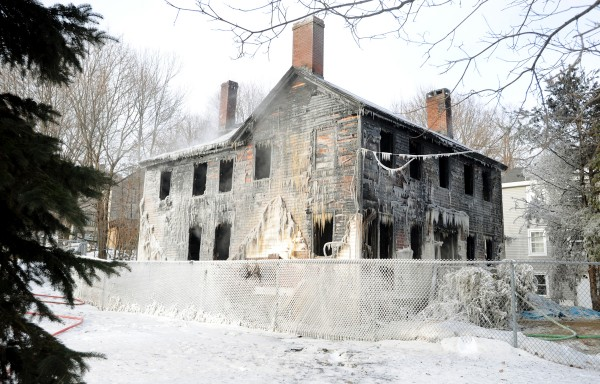City officials plan on demolition projects for two Court Street locations including the defunct police station and 150 Court St. (pictured) that was gutted this past winter after a fire started in the chimney.