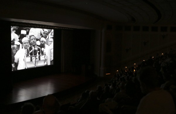 Viewers watch a film documentary, &quotThe March,&quot by James Blue about the 1963 March on Washington, at the National Archives in Washington August 27, 2013.