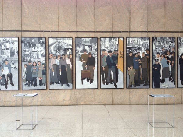 The Maine Labor History Mural, but Tremont artist Judy Taylor, on display in the atrium of the Maine State Museum. The museum has provided comment books for visitors to leave their thoughts on the mural and its controversial recent history.