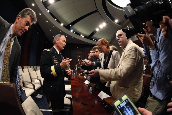 National Security Agency Director U.S. Army General Keith Alexander talks to reporters after testifying before a U.S. House Permanent Select Committee on Intelligence hearing on recently disclosed NSA surveillance programs, at the U.S. Capitol in Washington, June 18, 2013.