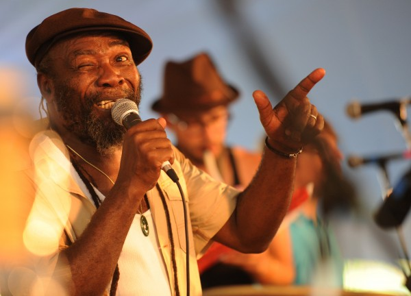 Legendary reggae singer-songwriter Clinton Fearon winks at his percussionist Ire' on Sunday at the Dance Stage. The eight-member band had all feet on the dance floor moving for its last song of the 2009 American Folk Festival.