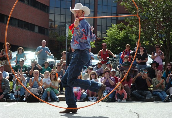 Brice Chapman of Lubbock, Texas, wows the crowd with his cowboy trick roping at the 2009 folk festival.