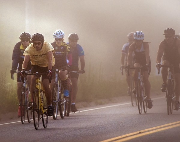 Cyclists taking part in the Champion The Cure Challenge organized by EMMC cancer care in Brewer, Maine begin their fifty mile ride down Dirigo Drive in Brewer, Maine through the fog after 7 am Saturday, August 17, 2013.