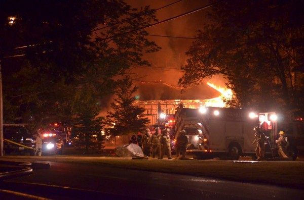 Firefighter crews attempt to control the fire at Westcustogo Grange Hall. The landmark building burned to the ground overnight Thursday and Friday morning.