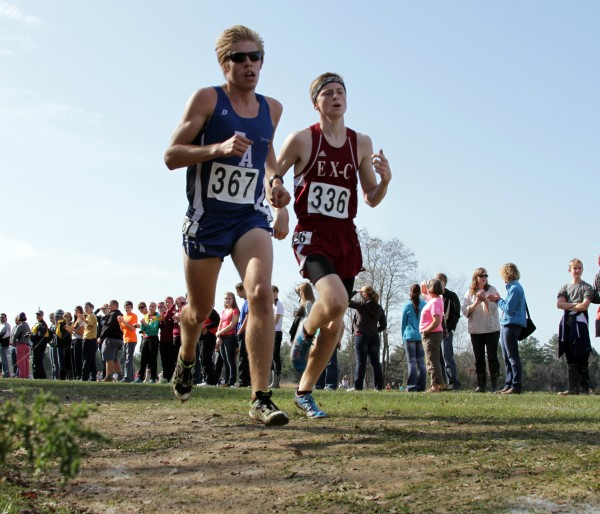 Fryeburg Academy's Silas Eastman (left) and Ellsworth's Dan Curts sprint to the finish line during the Class B state cross country championship race in 2012 at the Troy Howard Middle School course. Curts edged Eastman at the finish line by four-hundreths of second with a time of 15 minutes, 47.52 seconds over the 3.1-mile course.