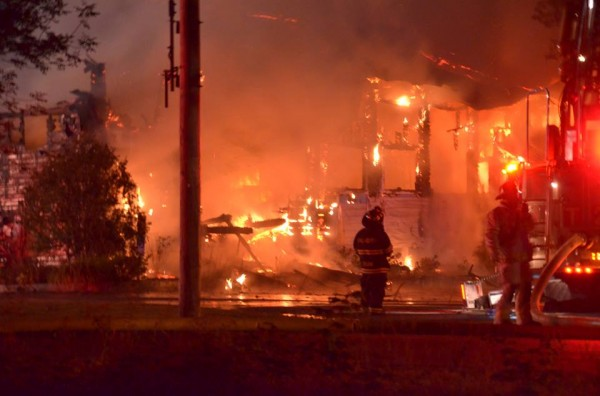 Firefighters battle the blaze at Westcustogo Grange Hall. It burned to the ground overnight Thursday and Friday.