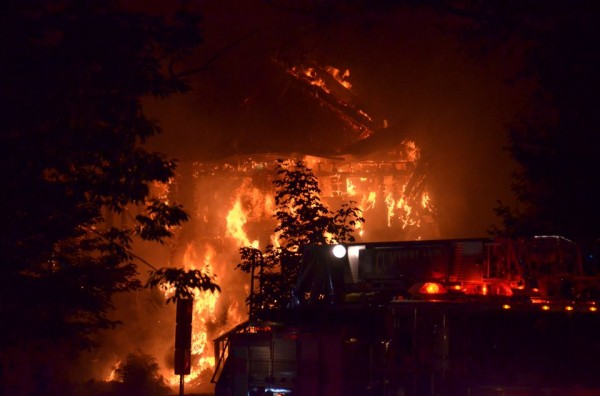 Fire engulfs the Westcustogo Grange Hall, where North Yarmouth residents held town meeting, weddings, Boy Scout meetings and aerobics. It burned to the ground overnight Thursday and Friday morning.